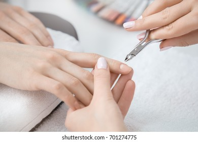 Young woman in manicure salon beauty care