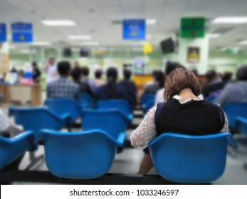 young woman and many people waiting medical and health services to the hospital,patients waiting treatment at the hospital,blurred image of people