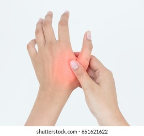 Young woman massaging her painful hand, suffering from hand pain isolated on a white background