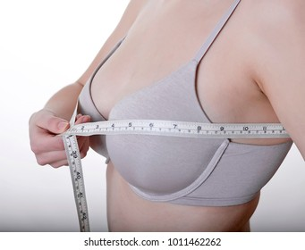 young woman measuring bust size