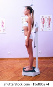 young woman measuring height