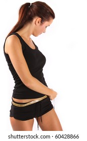 young woman measuring her waistline