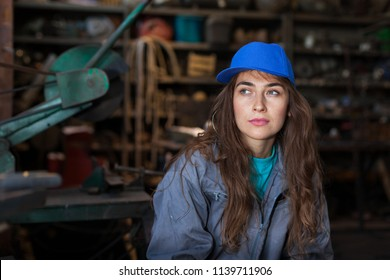 young woman mechanic in a workshop