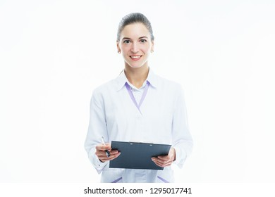 Young woman medic doctor practitioner with  folder in white uniform looking with a smile. Concept for a medical clinic. Health and health care. Nurse with a folder on a white background isolated.
