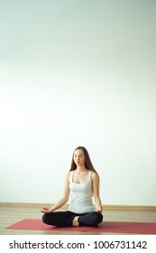 Young woman meditates while practicing yoga. Freedom concept