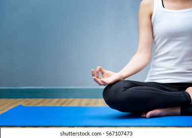 Young woman meditates while practicing yoga. Yoga concept, Calmness and relax, woman happiness.