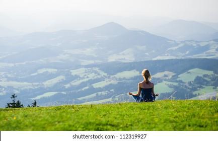 Young woman meditating outdoors