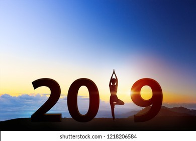Young woman in a meditating yoga on 2019 new year. healthy concept