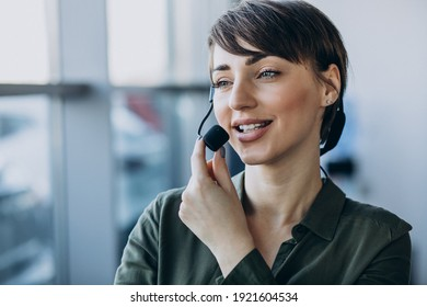 Young woman with microphone working on record studio