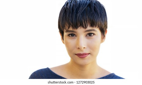 Young woman millennial, with short hair isolated against white.