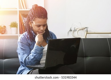 young woman modern with computer laptop on the sofa of the apartment