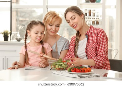 Young woman with mother and daughter in kitchen