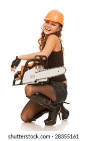 young woman with motor saw on a white background