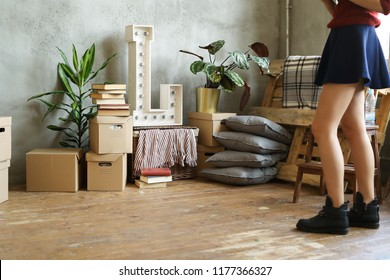 Young woman moving to new home