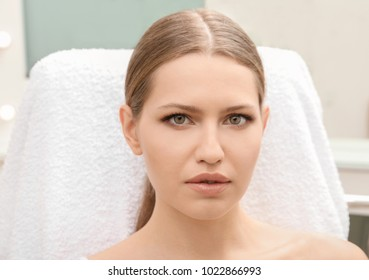 Young woman with natural eyebrows in salon