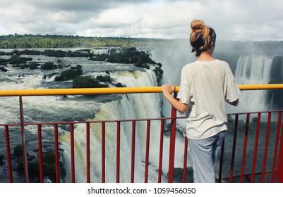 young woman near Iguazu Falls on Argentina and Brazil Borders