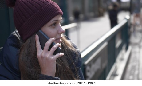 Young woman in New York speaks on the phone