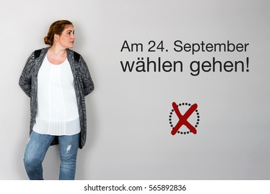 Young woman next to appeal in german to go voting during german federal election in September 2017