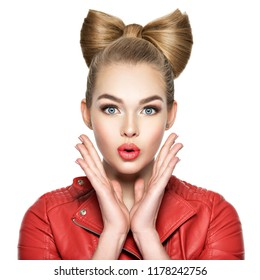Young woman with a nice hairstyle, red lipstick and a red jacket. Girl surprised and excited.