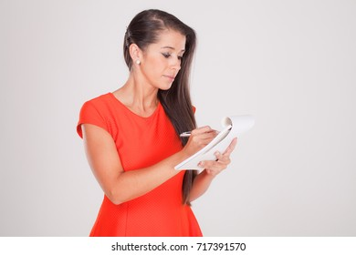 young woman with notebook on white VII