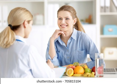 Young woman at nutritionist's office. Weight loss concept