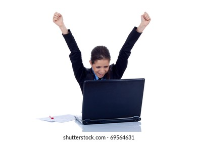 Young woman in office jubilates at desk. Isolated on white background.