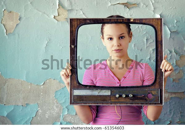young woman with old tv frame photo