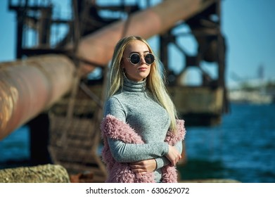 young woman on the background of metal structures