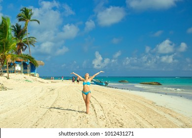 Young woman on the beach in Punta Cana, Dominican Republic. The Caribbean.