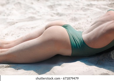 Young woman on the beach with white sand
