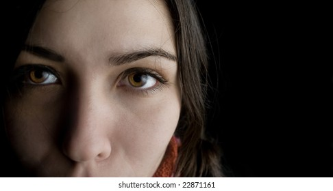 Young woman on black background