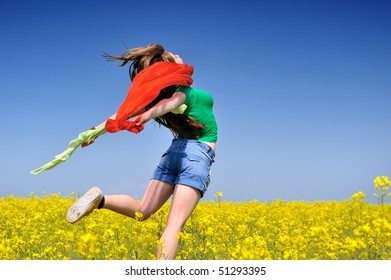 young woman on blooming rapeseed field