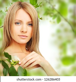 Young woman on blossom background