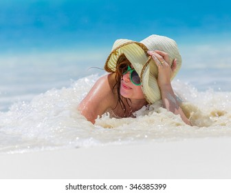 Young woman on the caribbean beach in Cuba