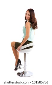 young woman on a chair on a white background.