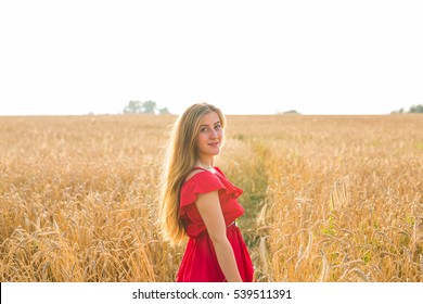 young woman on field in summer or autumn