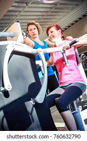 young woman on a fitness machine in a gym