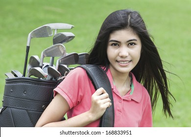 Young woman on a golf course on a sunny autumn day in the green background