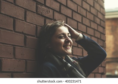 young woman on a green wall background is looking forward