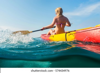 Young woman on kayak  in sea with blue sky background. Split photo.