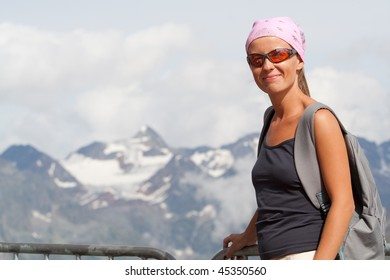 Young woman on move high in the mountains