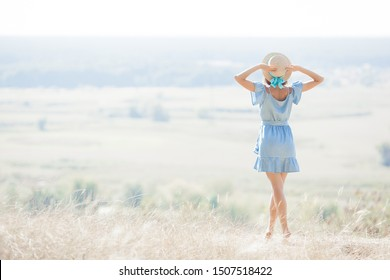 Young woman on nature background. Freedom. Female free.  Lady admires amazing natural view. Woman admires a landscape.