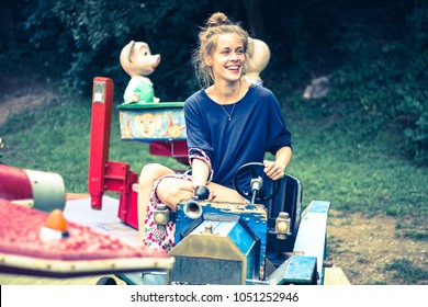 young woman on retro carousel