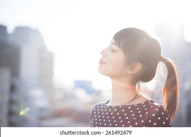 young woman on the roof