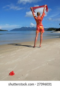 Young woman on a sandy beach. Langkawi, Malaysia