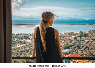 Young woman on seaside hotel balcony - Shutterstock ID 1838165299