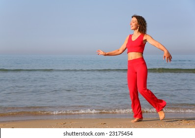Young woman on shore of sea