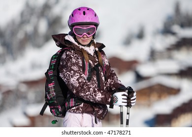 Young woman on ski resort. Winter vacation