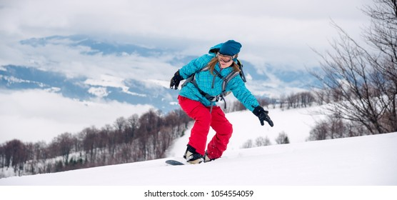 Young woman on the snowboard