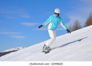 Young woman on snowboard